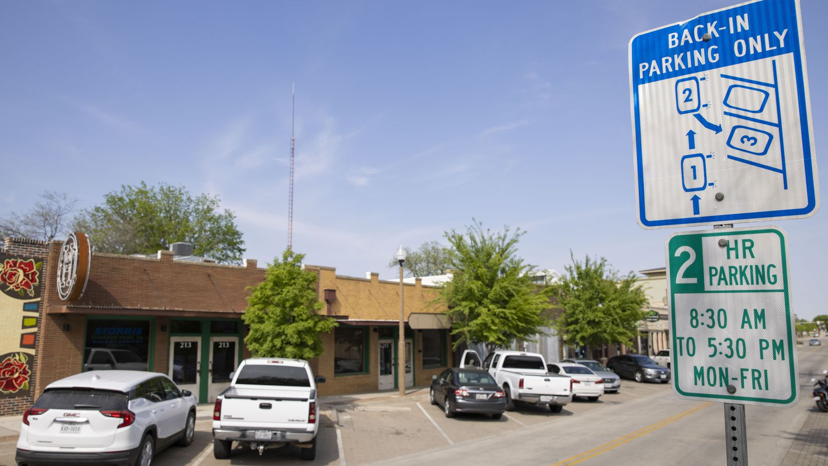 A back-in parking only sign on Hickory Street in Denton on Tuesday, Apr. 9, 2021.