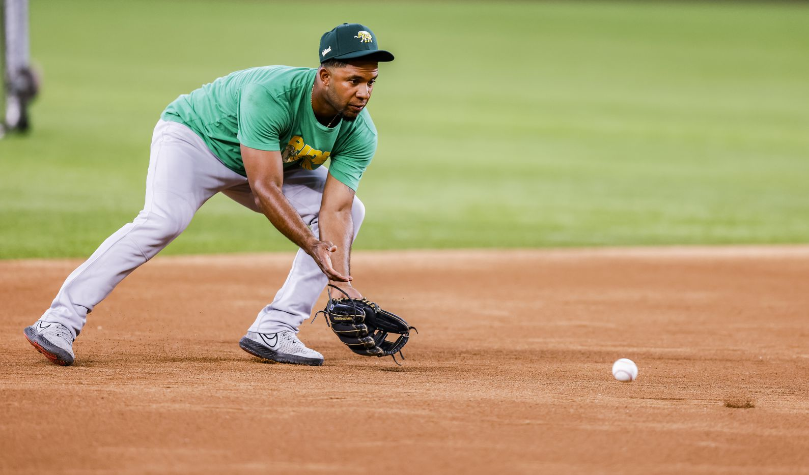 Oakland Athletics shortstop Elvis Andrus fields the ball during batting practice before a game against Texas Rangers in Arlington, Monday, June 21, 2021. (Brandon Wade/Special Contributor)