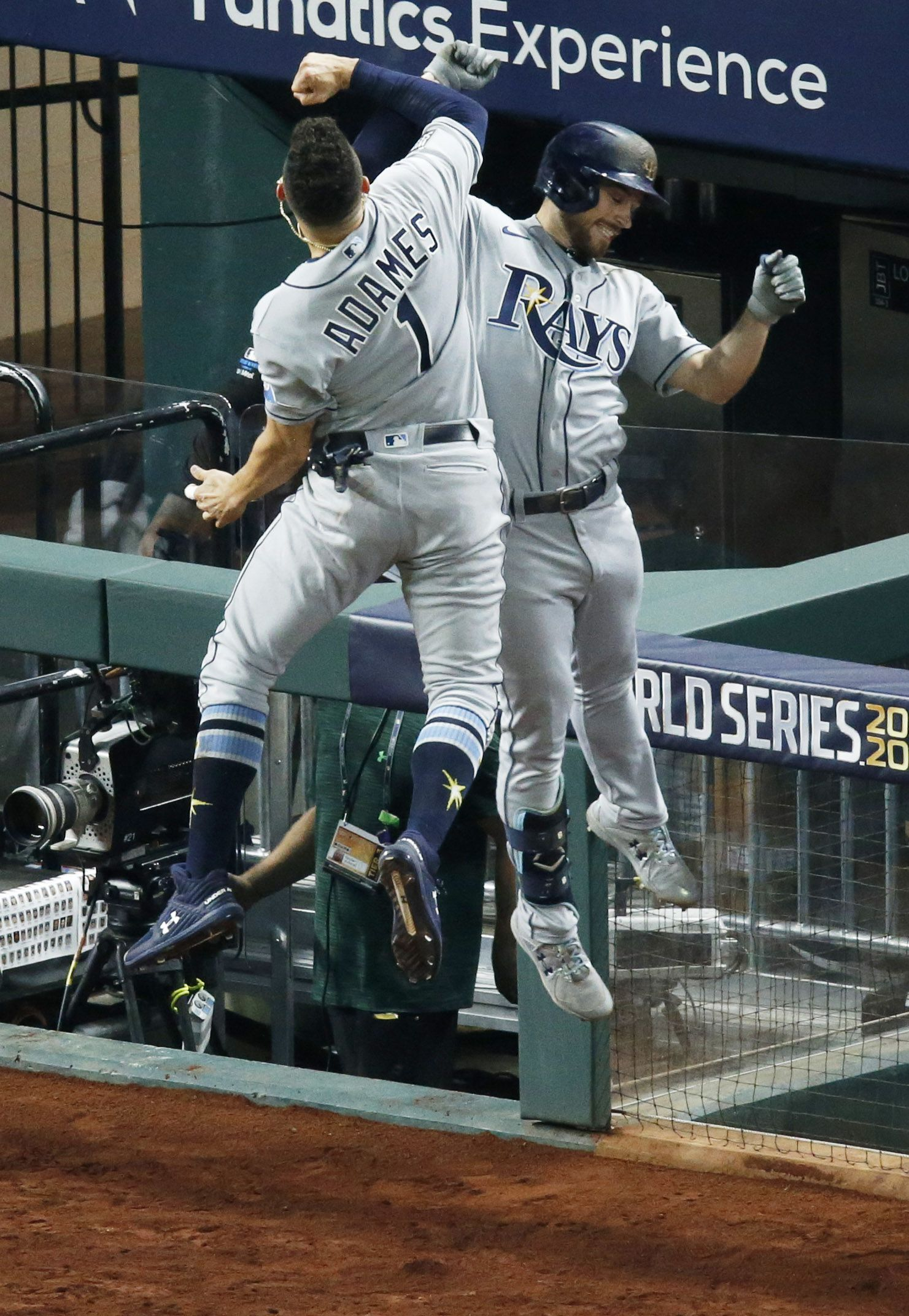 Tampa Bay Rays second baseman Brandon Lowe (8) and Tampa Bay Rays shortstop Willy Adames (1) celebrate after Lowe hit a two run home run during the fifth inning of game two against the Los Angeles Dodgers at the World Series at Globe Life Field on Monday, October 21, 2020 in Arlington, Texas. (Vernon Bryant/The Dallas Morning News)