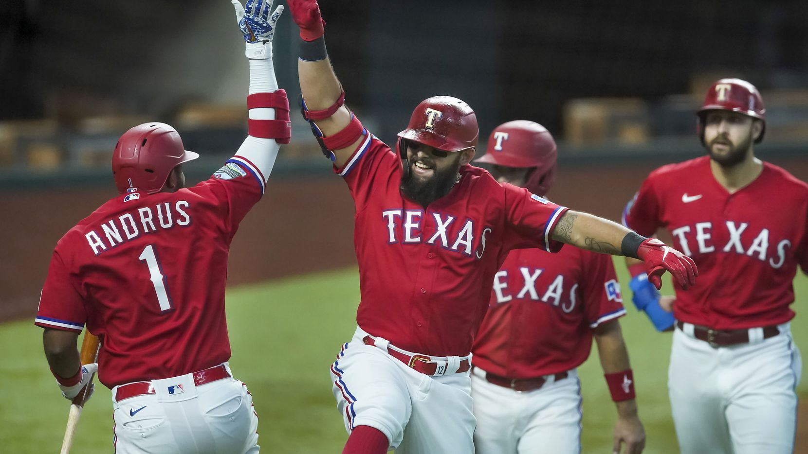 Texas Rangers second baseman Rougned Odor celebrates with shortstop Elvis Andrus after hitting a 3-run home run during the first inning against the Oakland Athletics at Globe Life Field on Saturday, Sept. 12, 2020.