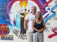 Martha Gonzalez-Skinner and her husband Steve Skinner outside of their home in front of a mural her husband painted honoring healthcare workers, July 02, 2020 in Plano. The couple was released from hospital care over a week ago due to the coronavirus.