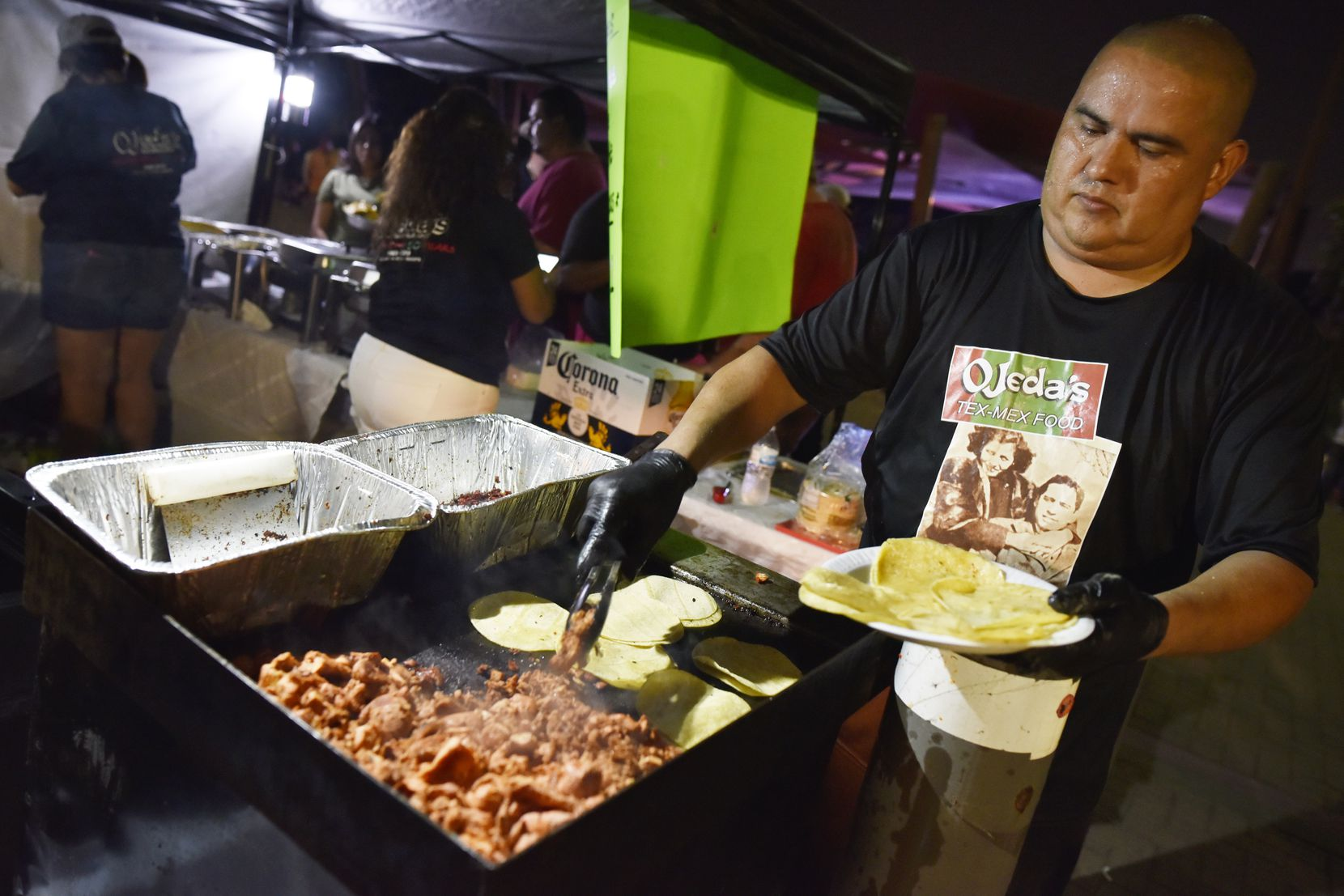 Oscar Carrillo of Ojeda's Restaurant prepares pork tacos at the 2019 Latino Heritage Festival in DeSoto. The 2021 event will be held Sept. 18.