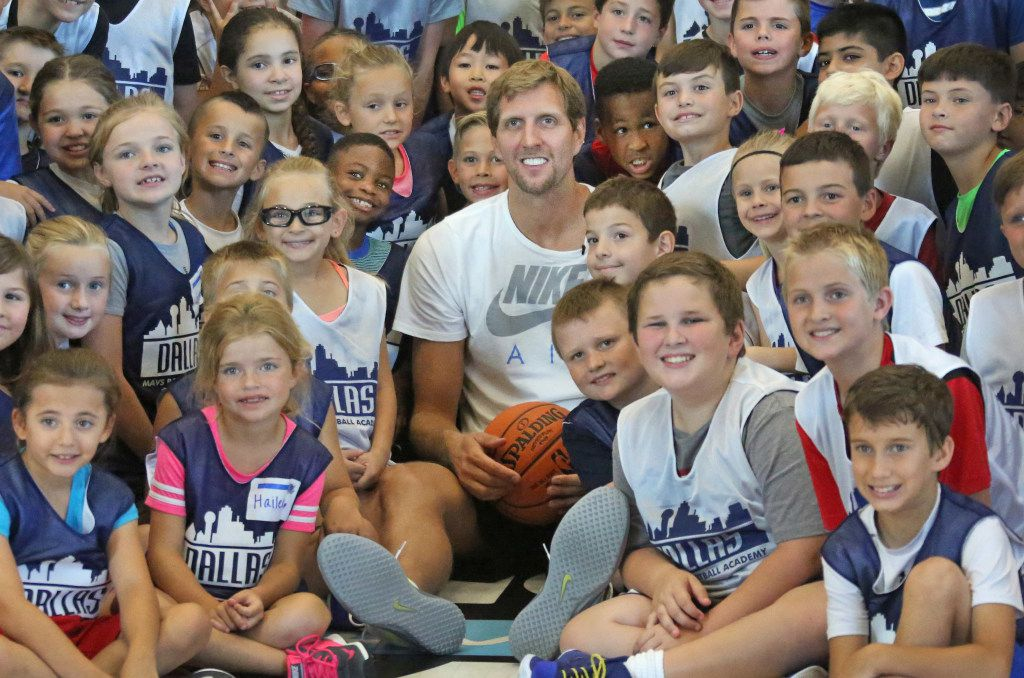 Dirk Nowitzki poses for a photo with the kids attending Mavs Basketball Academy Summer Hoop Camp in Allen on Tuesday, June 6, 2017.