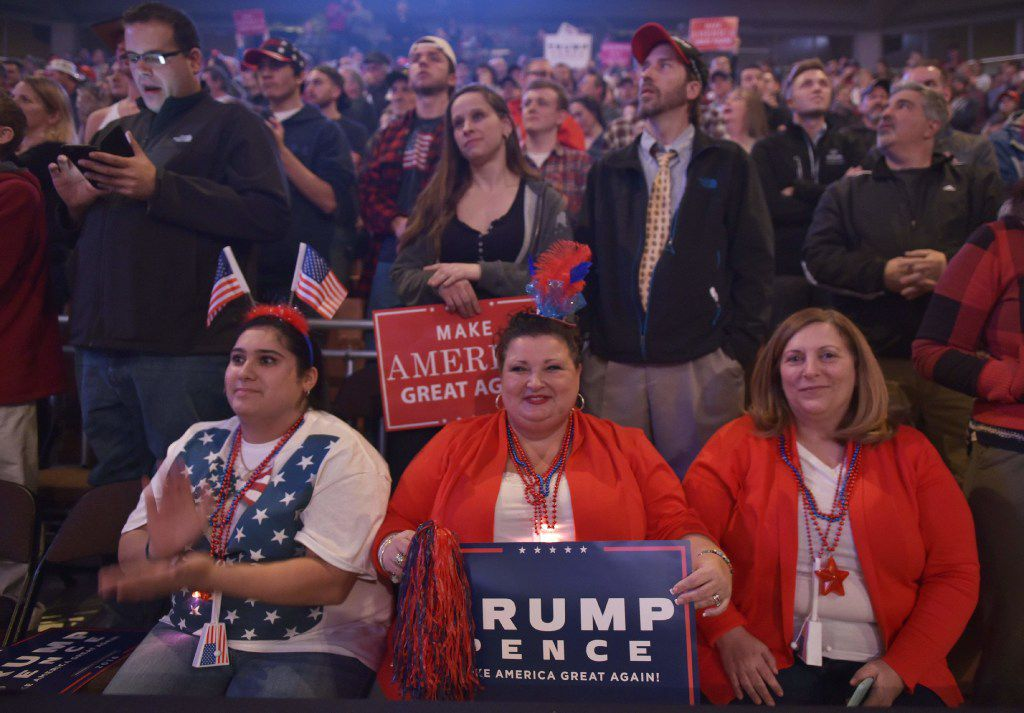Supporters listen as Republican presidential nominee Donald Trump addresses the final rally of his 2016 presidential campaign at Devos Place in Grand Rapids, Michigan on November 7, 2016. / AFP PHOTO / MANDEL NGANMANDEL NGAN/AFP/Getty Images