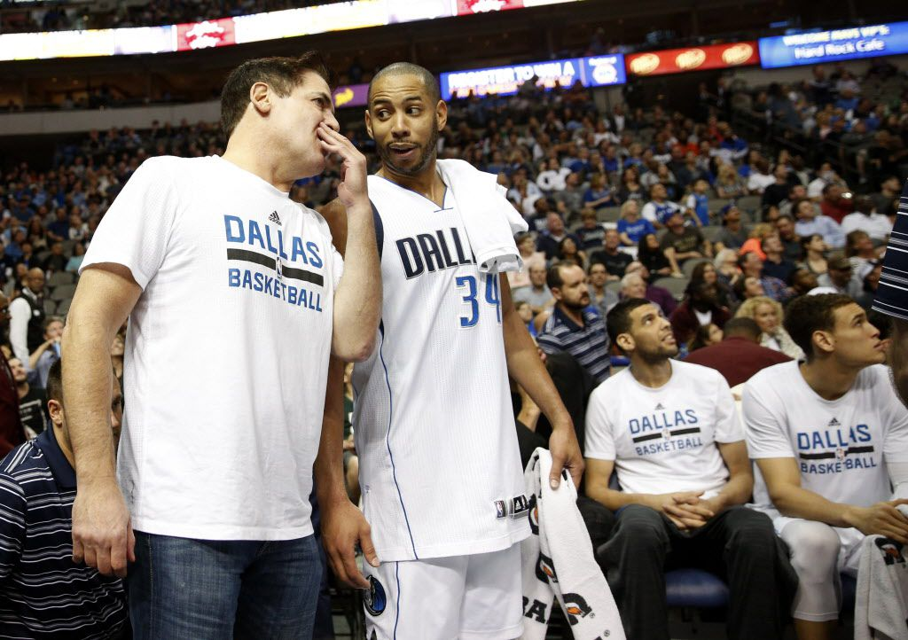 Dallas Mavericks owner Mark Cuban talks to Dallas Mavericks guard Devin Harris (34) during the second half against the Minnesota Timberwolves at the American Airlines Center in Dallas on Feb. 28, 2016. (Rose Baca/The Dallas Morning News)