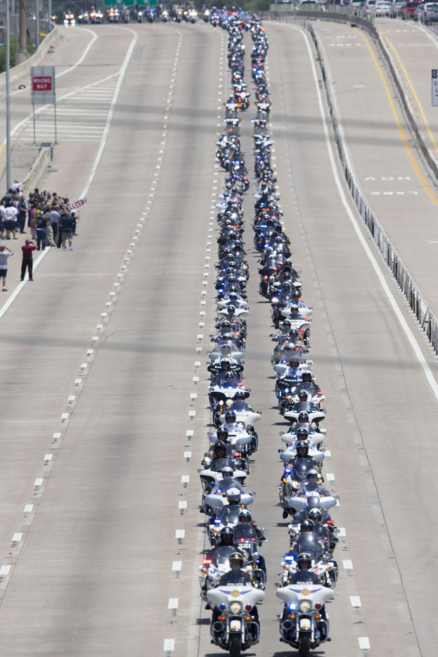 Police officers from all over the nation drive down US Hwy 75 during the funeral procession of Dallas police Sr. Cpl. Lorne Ahrens on July 13, 2016 in Richardson, Texas. Sr. Cpl. Lorne Ahrens was one of five officers killed, along with 7 other hurt during last Thursdays attack in downtown Dallas.