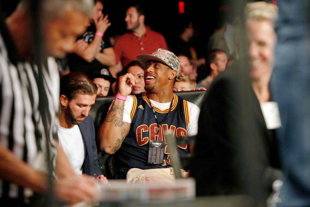 Former Dallas Cowboys defensive end Greg Hardy speaks with a fan as he sits ring side at Legacy Fighting Championship 61, on Friday, Oct. 14, 2016 at the Bomb Factory in Dallas. Ben Torres/Special Contributor