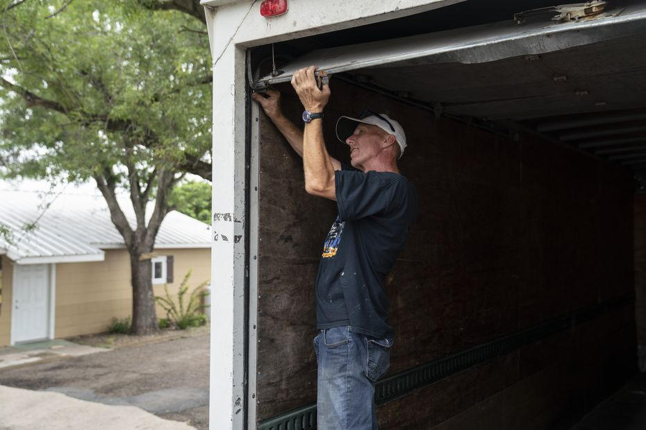 Dwayne Rhodes, 59, fixes a door on a Border Missions truck that brings donated produce from local stores in Hidalgo.
