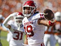 Oklahoma linebacker Caleb Kelly (19) celebrates recovering a Texas fumble on a kickoff return during the second half of an NCAA college football game at the Cotton Bowl in Fair Park, Saturday, October 9, 2021. Oklahoma won 55-48.