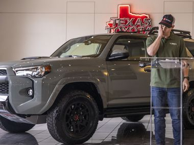 EMT Trey McDaniel emotionally reacts to his gift, a 2021 Toyota 4Runner TRD Pro, at the Texas Toyota of Grapevine dealership on Thursday, Feb. 25, 2021, in Grapevine, Texas.