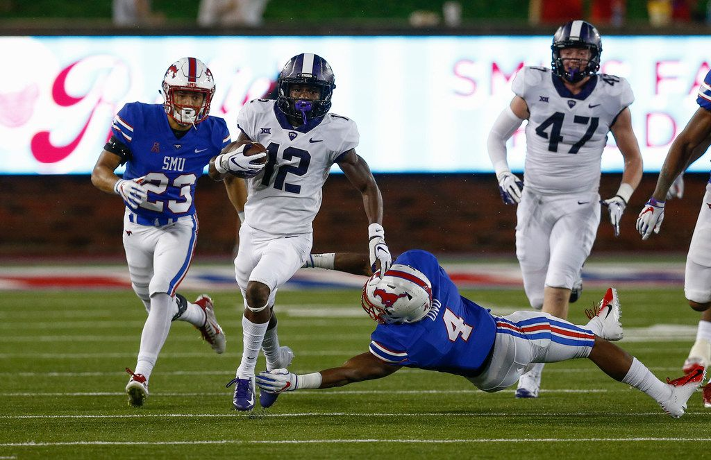 TCU wide receiver Derius Davis (12) runs after a catch. past SMU safety Mikial Onu (4) and cornerback Jordan Wyatt (23) during the second quarter of an NCAA college football game Friday, Sept. 7, 2018, in Dallas. (AP Photo/Jim Cowsert)