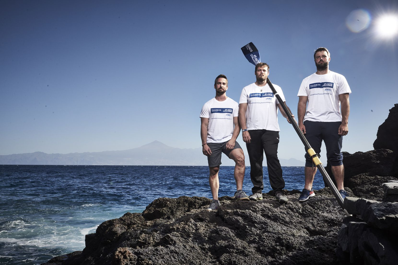 The American Oarsmen (from left) are David Alviar, Mike Matson and Brian Krauskopf, all from the Houston area. (Ben Duffy)