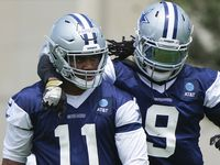Dallas Cowboys linebacker Jaylon Smith (9) puts an arm around linebacker Micah Parsons (11) during a minicamp practice at The Star on Tuesday, June 8, 2021, in Frisco. (Smiley N. Pool/The Dallas Morning News)