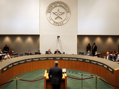 The Dallas City Council hears from a speaker during a meeting in council chambers. Federal prosecutors say a Dallas businessman, Ruel Hamilton, violated the conditions of his pretrial release by contacting a potential government witness in his City Hall bribery case.