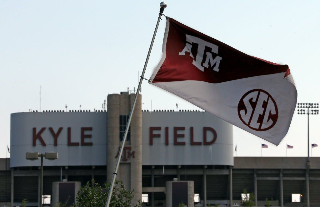 Texas A&M flags bearing the SEC logo bristle in the steady breeze outside Kyle Field before the University of Florida Gators vs. the Texas A&M Aggies NCAA college football game at Kyle Field in College Station on Saturday, September 8, 2012. (Louis DeLuca/The Dallas Morning News) 11242012xNEWS