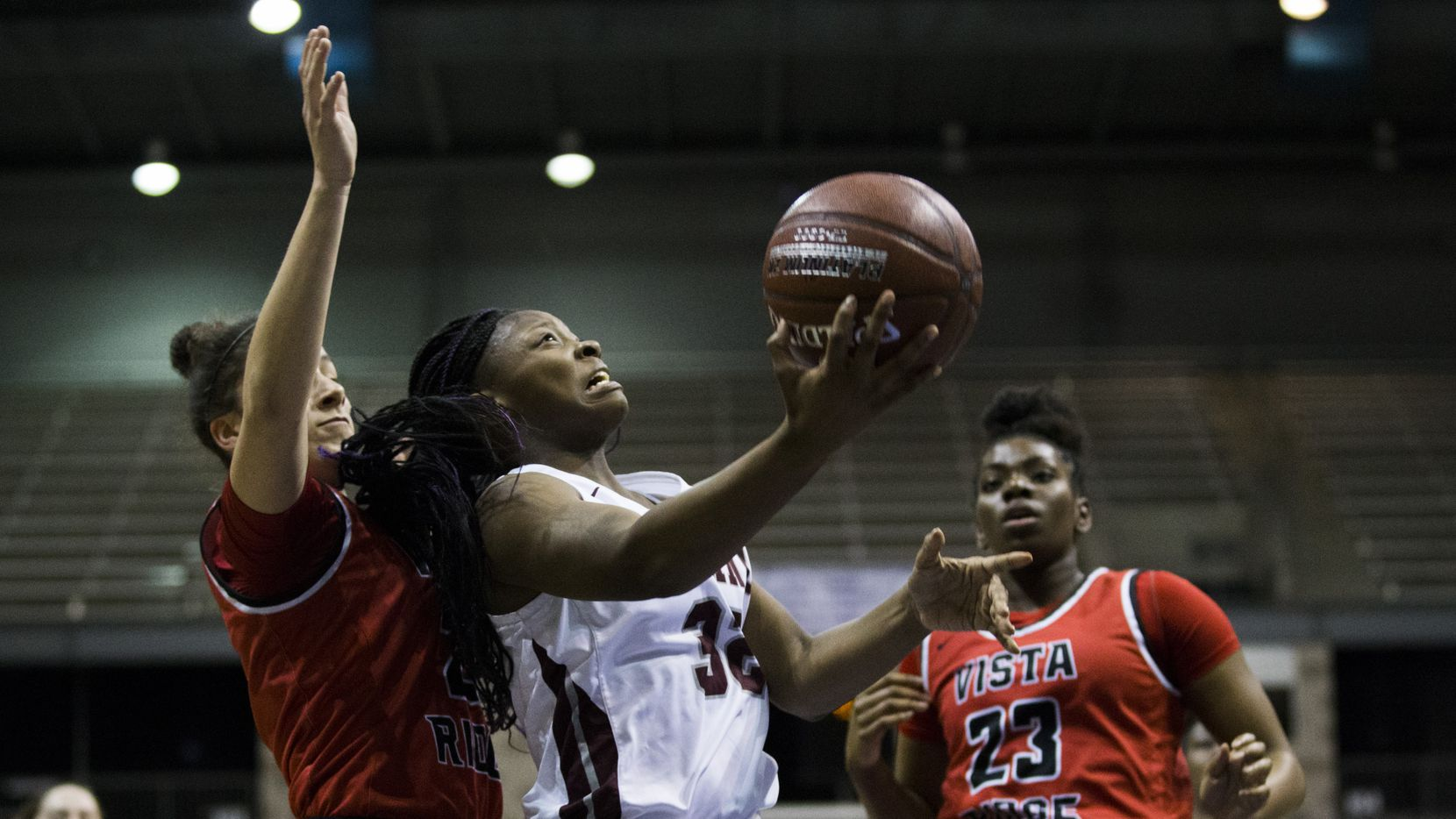 Plano guard Sanaa Murphy-Showers (32) goes up for a shot during the first quarter of a UIL 6A Region II semifinal girls basketball game between Plano and Cedar Park Vista Ridge on Friday, February 28, 2020 at Ellis Davis Field House in Dallas.
