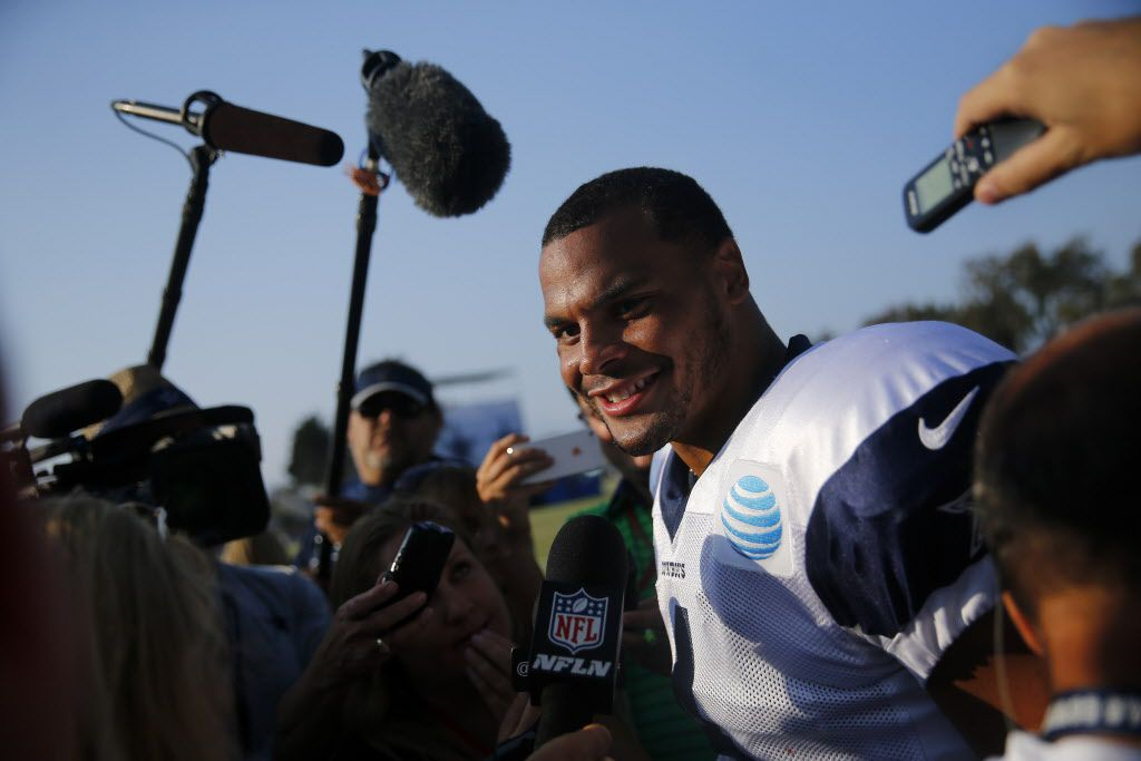 Dallas Cowboys quarterback Dak Prescott (4) smiles as he is interviewed after leading the first team during afternoon practice at training camp in Oxnard, California, Thursday, August 4, 2016. (Tom Fox/The Dallas Morning News)
