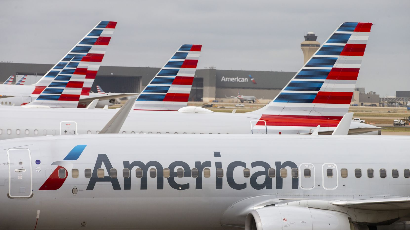 American Airlines planes parked at Terminal D at DFW Airport, Wednesday, October 21, 2020. (Brandon Wade/Special Contributor)