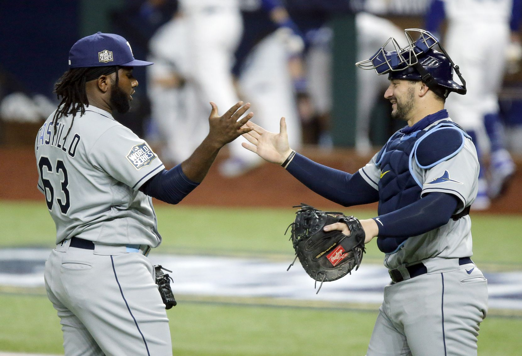 Tampa Bay Rays catcher Mike Zunino (10) congratulates relief pitcher Diego Castillo (63) on the 6-4 win over the Los Angeles Dodgers in Game 2 of the World Series at Globe Life Field in Arlington, Wednesday, October 21, 2020. (Tom Fox/The Dallas Morning News)
