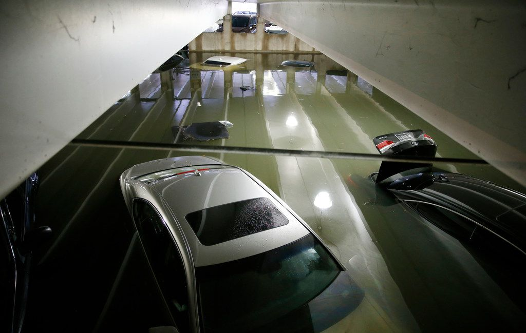 Flooded cars parked in the lower level of parking garage A at Dallas Love Field under water due to heavy rains overnight in Dallas on Wednesday, April 23, 2019. The airport closed the lower level to traffic. Water is being pumped from the flooded areas by city staff employees. (Vernon Bryant/The Dallas Morning News)
