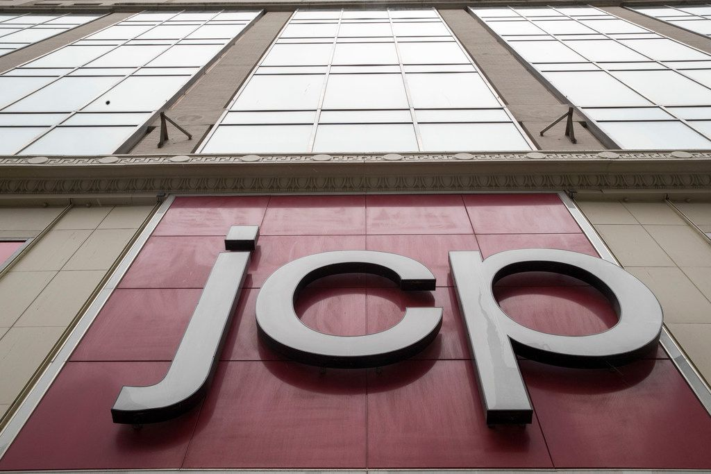 The J.C. Penney logo and stock symbol is seen hanging outside the Manhattan Mall in New York.