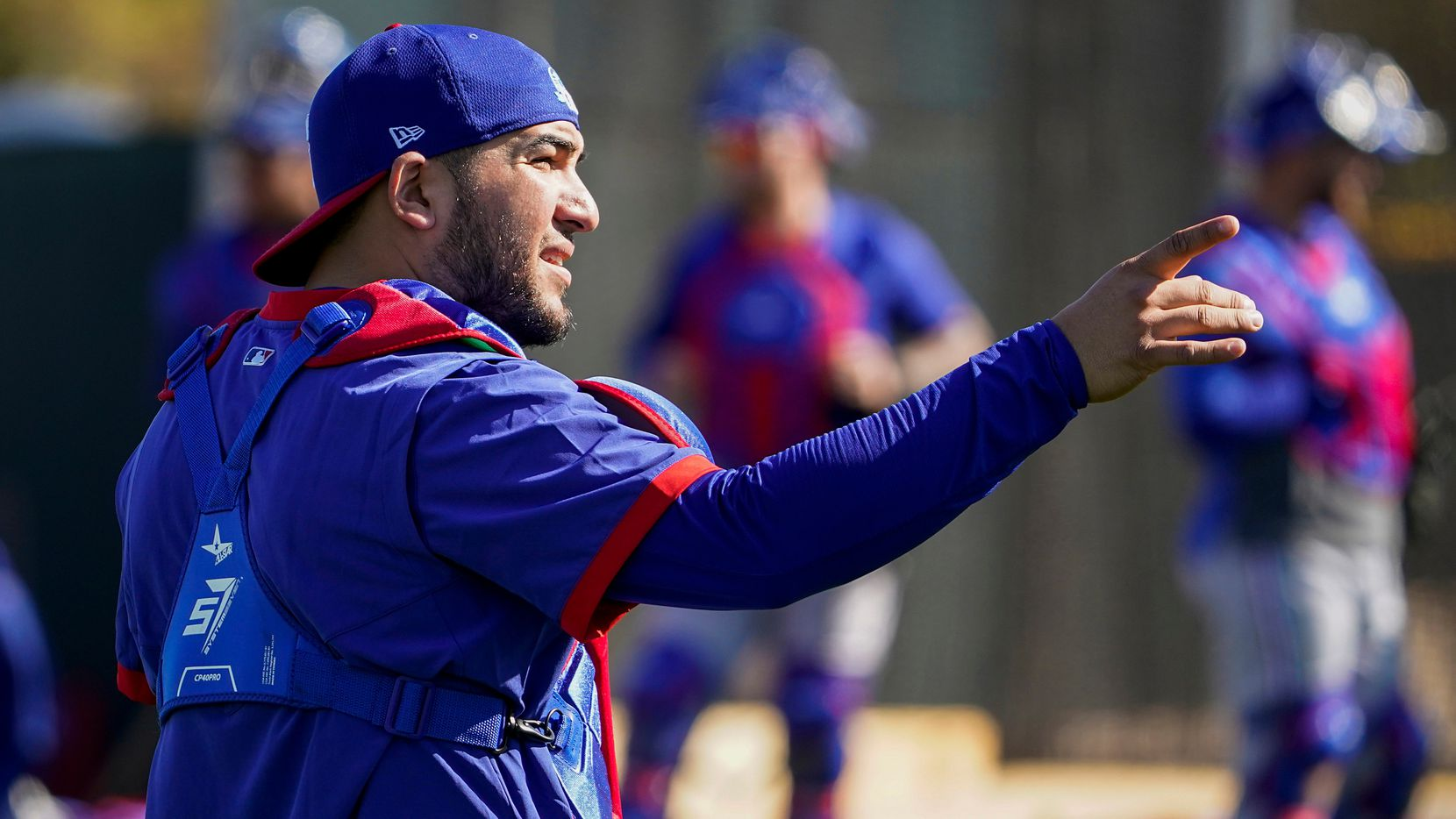 Texas Rangers catcher Jose Trevino works in the bullpen during a training workout at the team's training facility on Thursday, Feb. 13, 2020, in Surprise, Ariz.