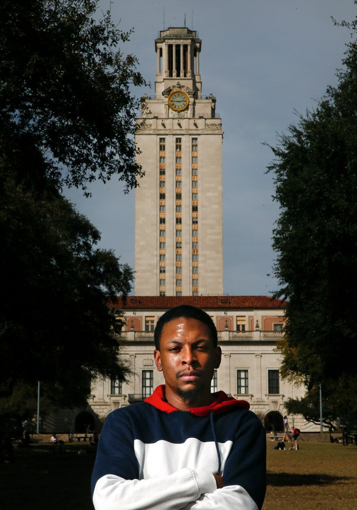 """Joshua Ellis, African and African Diaspora studies senior, poses for a portrait with the UT tower in Austin on Feb. 15, 2019. Ellis said he doesn't sing the school's spirit song, """"The Eyes of Texas,"""" because of its racist history."""
