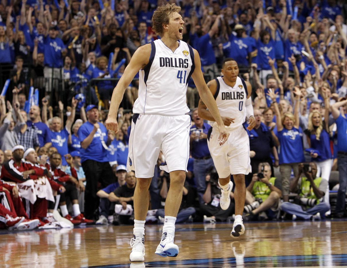 Dallas Mavericks power forward Dirk Nowitzki (41) reacts after hitting a three pointer against Miami Heat shooting guard Dwyane Wade (3) in the third quarter during Game 3 of the NBA Finals at American Airlines Center Sunday, June 5, 2011 in Dallas.  (Tom Fox/The Dallas Morning News) 08102011xSPORTS