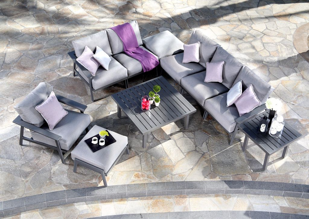 Contemporary sofa/chair sets in a gray palette, like the Dakoda from Mallin Casual Furniture, offer flexibility in outdoor seating.