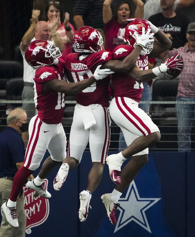 Arkansas wide receiver Treylon Burks (16) celebrates with wide receiver Tyson Morris (19) and wide receiver De'Vion Warren (10) after scoring on a 85-yard touchdown reception during the first half of an NCAA football game against Texas A&M at AT&T Stadium on Saturday, Sept. 25, 2021, in Arlington.