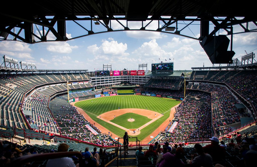 Sparse fans watch an MLB game between the Texas Rangers and the Seattle Mariners on Sunday, September 1, 2019 at Globe Life Park in Arlington. (Ashley Landis/The Dallas Morning News)