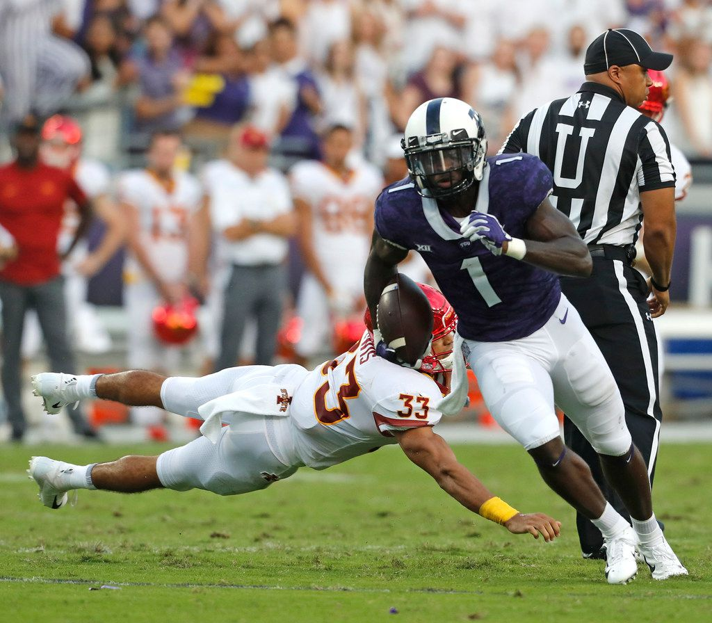 TCU wide receiver Jalen Reagor (1) escapes the tackle of Iowa State defensive back Braxton Lewis (33) in the first half of a NCAA college football game at Amon G. Carter Stadium Saturday September 29, 2018. (Bob Booth/Special Contributor)