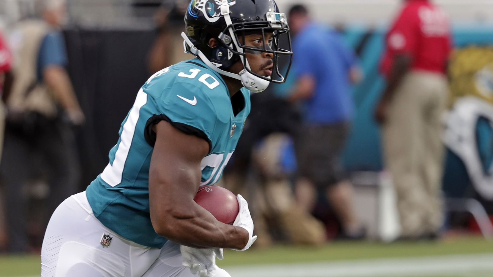 FILE - Jacksonville Jaguars running back Corey Grant returns a kickoff against the New Orleans Saints during the first half of an NFL preseason football game, Thursday, Aug. 9, 2018, in Jacksonville, Fla. (AP Photo/John Raoux)