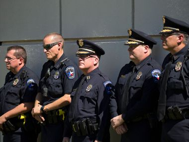 A file photo shows Mesquite Police Department officers attending the public dedication of Freedom Park at Mesquite Arts Center. Rather than a public gathering at the park to remember the events of Sept. 11, 2001, the city will host a virtual event this year.