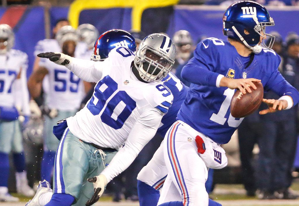 Dallas Cowboys defensive end Demarcus Lawrence (90) pressures New York Giants quarterback Eli Manning (10) uring the Dallas Cowboys vs. the New York Giants NFL football game at MetLife Stadium in East Rutherford, New Jersey on Sunday, December 11, 2016. (Louis DeLuca/The Dallas Morning News)