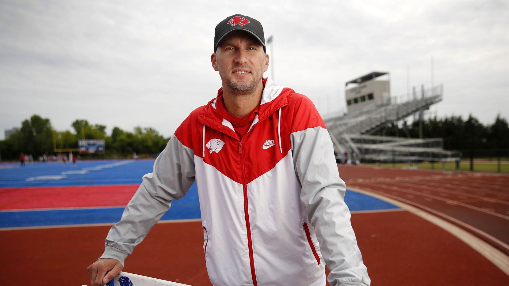 Parish Episcopal head track coach Jeremy Wariner poses for a photo at the schools stadium in Dallas, Wednesday, April 21, 2021. The former Arlington Lamar and Baylor star who won three Olympic gold medals — one in the 400 meters and two in the 4x400 relay — took over the program after retiring from competition.