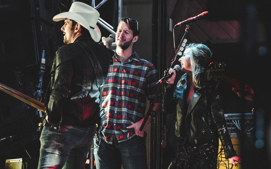 Brad Paisley hands the microphone to Clayton Kershaw, pitcher for the Los Angeles Dodgers, during a surprise performance at The Rustic on Nov. 9, 2017. His wife Ellen Kershaw helped put on the charity event.