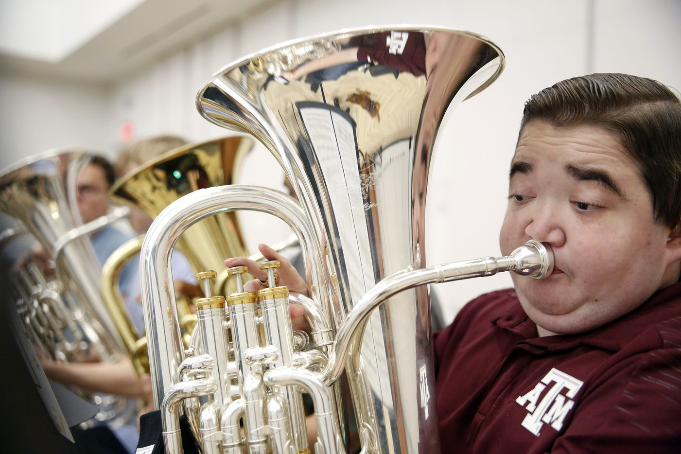 Texas A&M graduate student Kyle Cox (right in wheelchair), who has Duchenne Muscular Dystrophy, warms up his baritone before symphonic band rehearsal at the new Music Activities Center on the Texas A&M campus in College Station, Texas, Wednesday, September 11, 2019. (Tom Fox/The Dallas Morning News)
