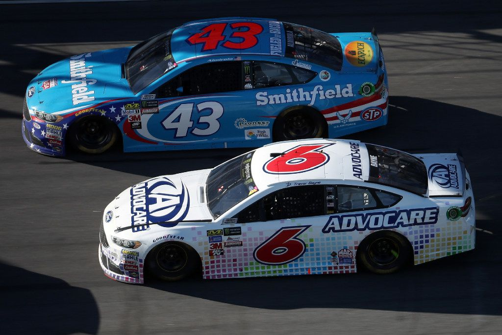 DAYTONA BEACH, FL - FEBRUARY 26:   Aric Almirola, driver of the #43 Smithfield Foods Ford, races Trevor Bayne, driver of the #6 AdvoCare Ford, during the 59th Annual DAYTONA 500 at Daytona International Speedway on February 26, 2017 in Daytona Beach, Florida.  (Photo by Chris Graythen/Getty Images)