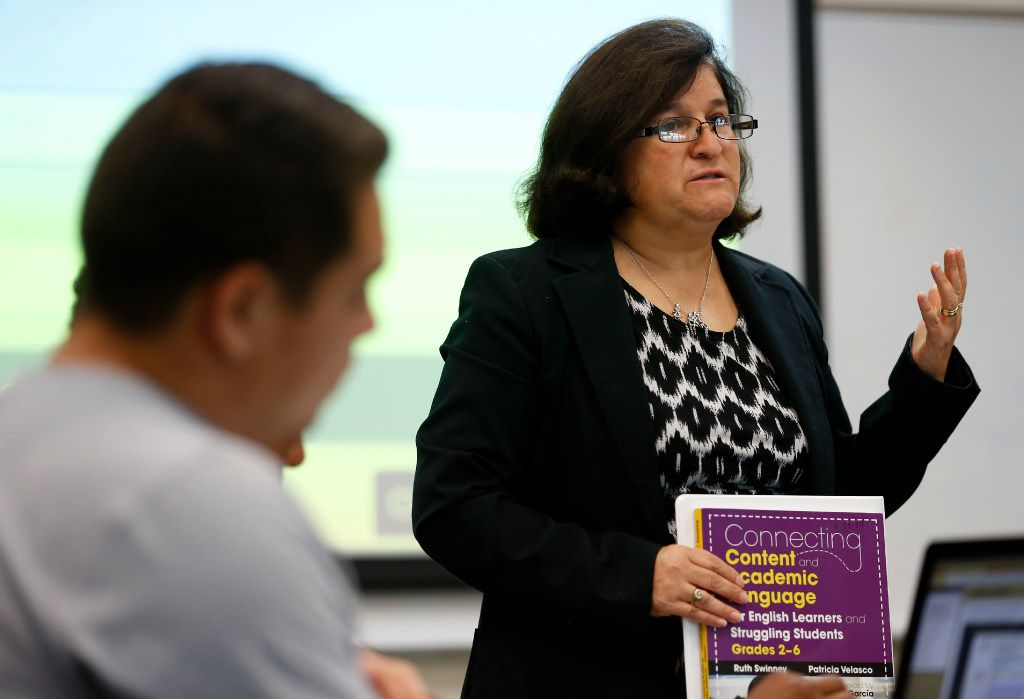 Ana Cocoa, an adjunct professor in UNT Dallas' School of Education, leads an educational leadership class.