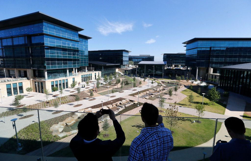 Employees take photos of the new facility after a brief ceremony welcoming the first wave of employees to the new Toyota North American headquarters in Plano on Monday, May 15, 2017.