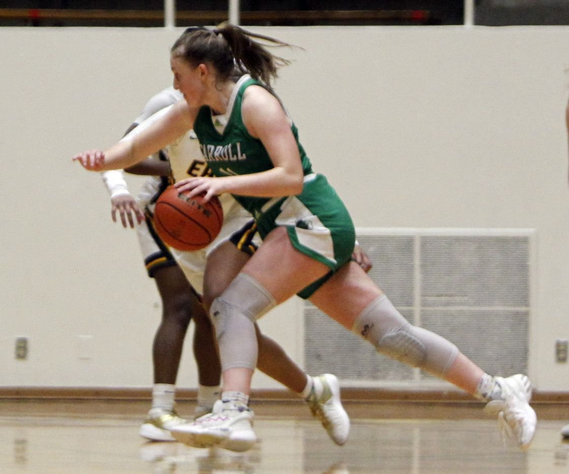 Southlake Carroll guard Kaelyn Riley (11) drives at the top of the key against the Plano East defense during first half action. The two teams played their Class 6A regional semifinal girls playoff basketball game at Loos Field House in Addison on February 27, 2021. (Steve Hamm/ Special Contributor)