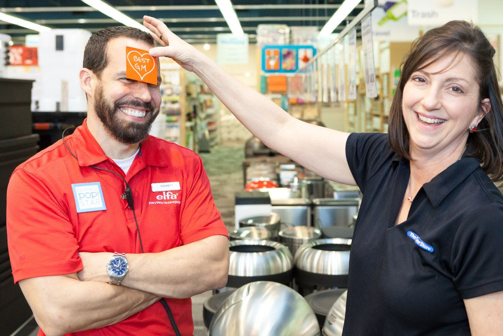 Lori Bartz, a salesperson in The Container Store s Southlake store, puts a Post-It Note on general manager Kenneth Deal s forehead on Valentine's Day.