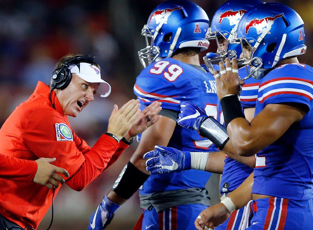 Southern Methodist Mustangs head coach Chad Morris encourages his players to keep fighting against the TCU Horned Frogs in the second half at Gerald J. Ford Stadium in University Park, Texas, Friday, September 23, 2016. (Tom Fox/The Dallas Morning News)