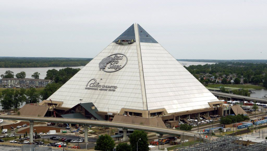 In this April 27, 2015 photo, the new Bass Pro Shop store stands near the Mississippi River in Memphis, Tenn. The store, which opens April 29, is in the Memphis landmark known as the Pyramid. Bass Pro and the city agreed on a 55-year-lease in 2010, and construction to convert the 535,000-square foot building from arena to megastore began four years ago. (AP Photo/Karen Pulfer Focht) 05032015xTRAVEL