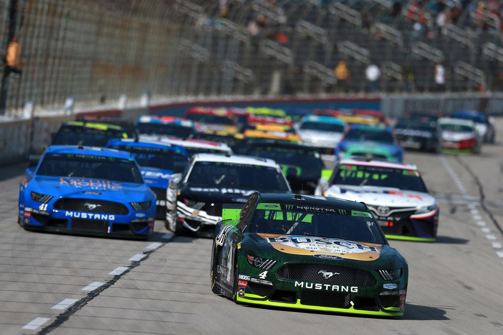 FORT WORTH, TEXAS - NOVEMBER 03: Kevin Harvick, driver of the #4 Busch Beer/Ducks Unlimited Ford, leads the field during the Monster Energy NASCAR Cup Series AAA Texas 500 at Texas Motor Speedway on November 03, 2019 in Fort Worth, Texas.