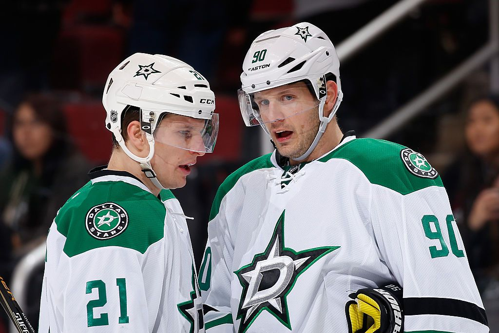 GLENDALE, AZ - FEBRUARY 18:  Antoine Roussel #21 and Jason Spezza #90 of the Dallas Stars during the NHL game against the Arizona Coyotes at Gila River Arena on February 18, 2016 in Glendale, Arizona. The Coyotes defeated the Stars 6-3.  (Photo by Christian Petersen/Getty Images)
