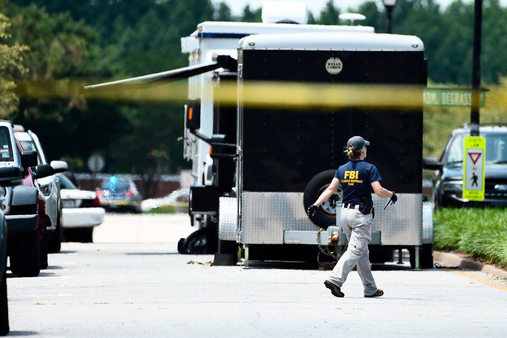 """FBI agents work near building number 2 at the Virginia Beach Municipal Center, the scene of the mass shooting, in Virginia, Beach, Virginia on June 1, 2019. - A municipal employee sprayed gunfire """"indiscriminately"""" in the government building complex on May 31, 2019, police said, killing 12 people and wounding four in the latest mass shooting to rock the US. (Photo by Eric BARADAT / AFP)ERIC BARADAT/AFP/Getty Images"""