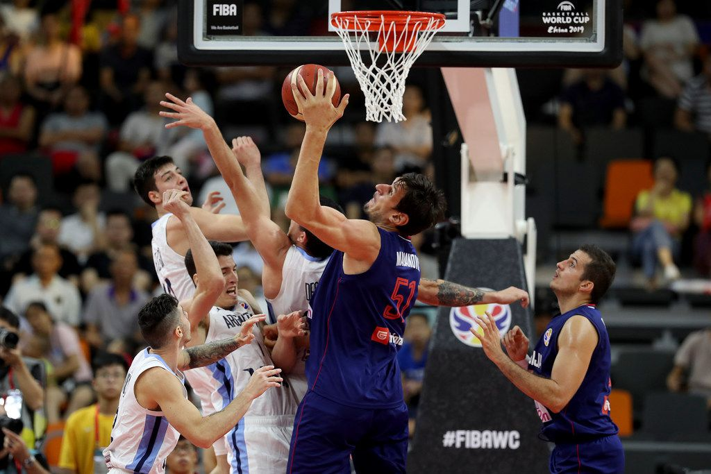 Serbia's Boban Marjanovic secures the ball from Argentina's players during a quarterfinal match for the FIBA Basketball World Cup in Dongguan in southern China's Guangdong province on Tuesday, Sept. 10, 2019. Argentina beats Serbia 97-87.