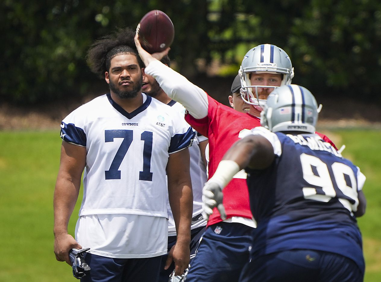 Dallas Cowboys tackle La'el Collins (71) watches quarterback Cooper Rush (10) throw a pass under pressure from defensive tackle Justin Hamilton (99) during a minicamp practice at The Star on Tuesday, June 8, 2021, in Frisco. (Smiley N. Pool/The Dallas Morning News)